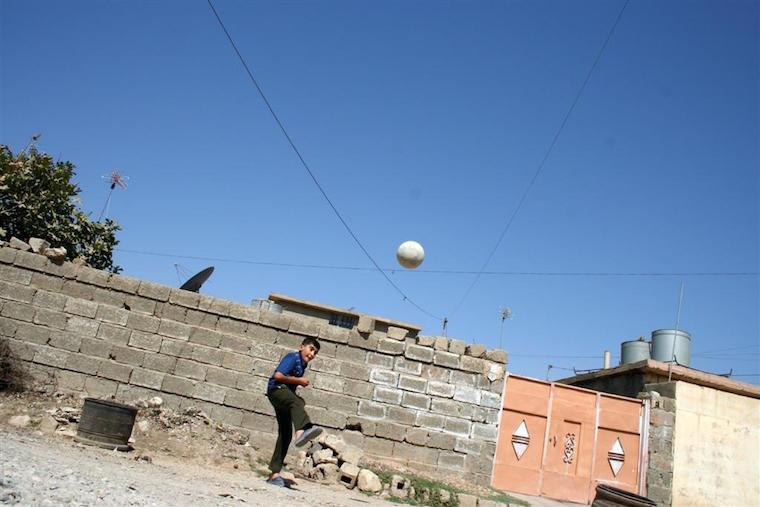 Aras kicking a soccer ball