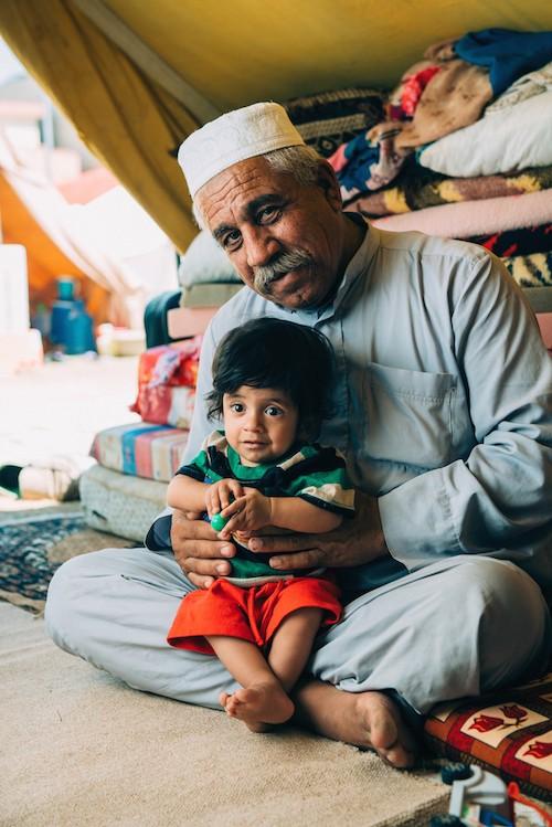 A photo of Majid and his son, Ishaq