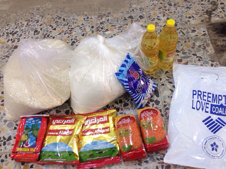 Contents of a food basket delivered as emergency relief to formerly displaced Iraqi families trying to settle in their hometown.