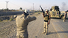 Iraqi security forces and Iraqi Shia militias stand guard after breaking a siege on Amerli by the Isis extremist group