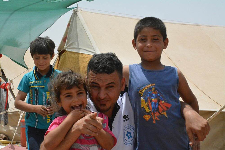 A family, newly displaced from the city of Ramadi in Iraq, receives relief aid from Preemptive Love Coalition.