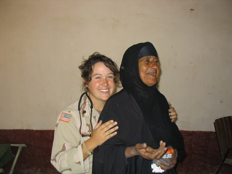 Diana Oestreich was part of the US forces in Iraq during the US invasion. In this photo she stands with a local Iraqi woman. Diana helped her receive medical care.