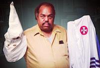 Daryl Davis holding Klan uniform