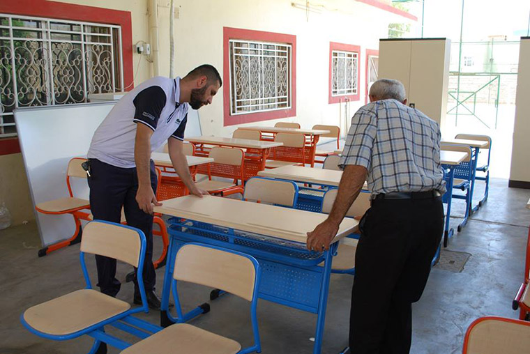 Desks and white boards are delivered to Kirkuk, for a summer education programme, which will combine students from different ethnic and religious backgrounds.
