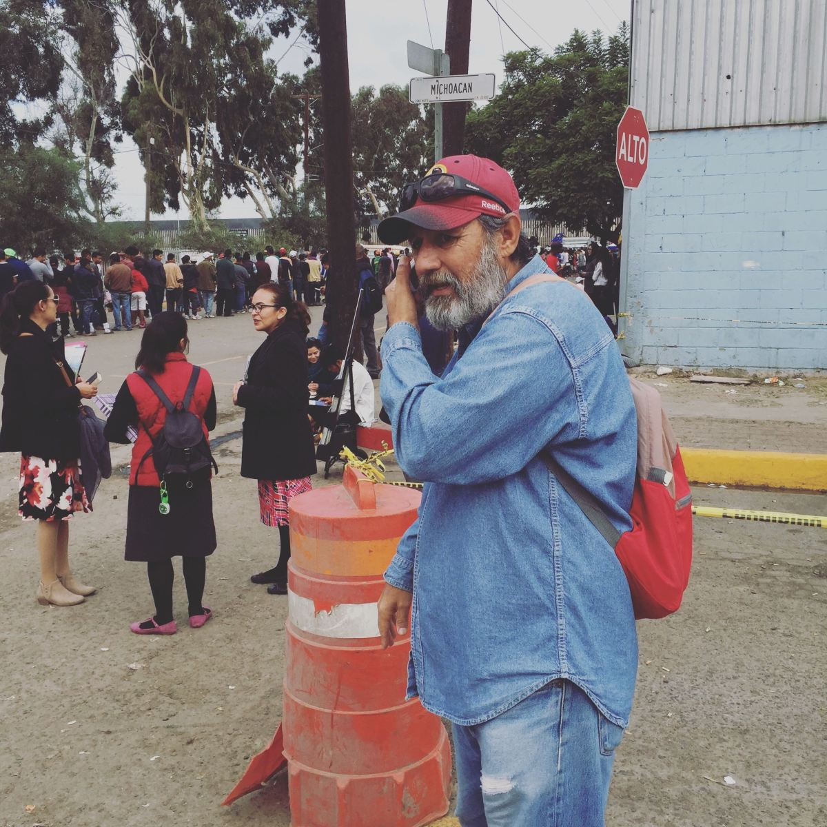 Felix, who volunteered to help Matt translate interviews from Spanish to English, takes a call in Tijuana.